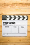 Movie slate film on wooden table Stock Photo