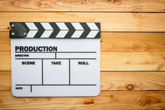 Movie slate film on wooden table Royalty Free Stock Image