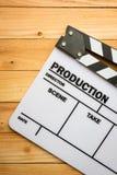 Movie slate film on wooden table Stock Photos