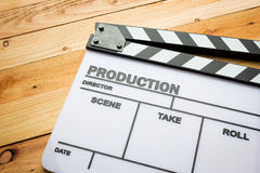 Movie slate film on wooden table Royalty Free Stock Photos