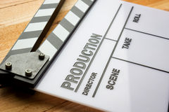 Movie slate film on wooden table Royalty Free Stock Images