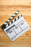 Movie slate film on wooden table Stock Photography