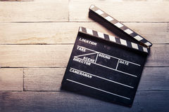Movie slate on a wooden background Stock Photos