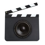 Movie soundtrack concept. Audio speaker on a movie production clapper board isolated on white background Royalty Free Stock Photos