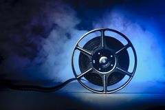 Movie spool with film Royalty Free Stock Image