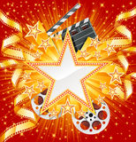 Movie star. Golden star with golden film, on the shiny background Royalty Free Stock Photos