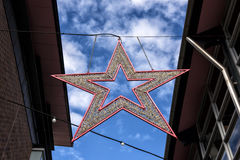 Movie Star, Fox Studios. The star shape hangs between buildings to celebrate film actors at Fox Studio, Sydney Australia Royalty Free Stock Image