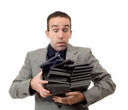 Movie Store Manager. Carrying a pile of empty dvd cases, isolated against a white background Royalty Free Stock Images
