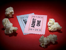 Movie stub. Close up shot of two generic admission tickets and some popcorns arround Royalty Free Stock Images