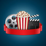 Movie template. Abstract movie template. Cinema concept with popcorn, reel and film clapper. EPS10 vector Stock Photography