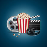 Movie template. Abstract movie template. Cinema concept with popcorn, reel, filmstrip and film clapper. EPS10 vector Stock Images