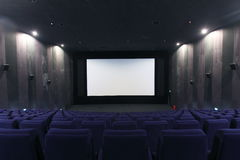 Movie Theater. Hall of a cinema and lines of blue armchairs Stock Images