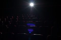 Movie theater background, red seats in cinema hall Royalty Free Stock Images