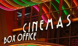 Movie theater box office. Colorful illuminated movie theater ticket booth sign Stock Image