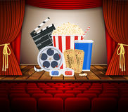 Movie theater with row of red seats. Clapperboard, soda and popcorn and ticket movie. Movie cinema premiere poster design Stock Image