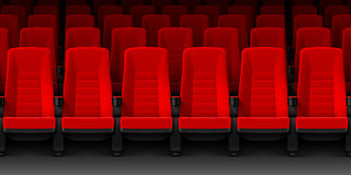 Movie theater with rows of red empty chairs Stock Photos