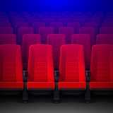 Movie theater with rows of red empty chairs. And spotlight, cinema hall seats Stock Photo