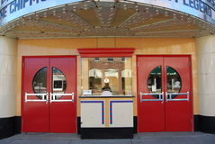Movie Theater Ticket Booth. The entrance and ticket booth on an old restored movie theater Stock Photography