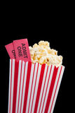 Movie ticket and popcorn on a black background royalty free stock photo