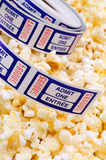 Movie Tickets. Roll Of Movie Tickets On A Background Of Popcorn Royalty Free Stock Photos