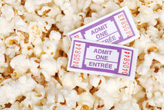 Movie tickets and popcorn. Closeup of Movie tickets and popcorn Royalty Free Stock Images