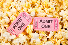 Movie tickets and popcorn. Movie tickets in a pool of freshly popped popcorn Stock Images