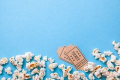 Movie tickets and popcorn on blue background. Copy space for text.  Stock Photo