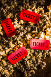 Movie tickets on scattered popcorn Stock Image