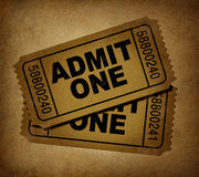Movie tickets vintage. Movie tickets with vintage grunge texture representing two stubs that admit one for show business price to enter and the cinematic theater Stock Photos