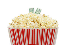 Movie Time. Two admission stubs on top of a bucket of popcorn Stock Photography