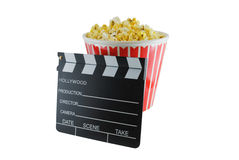Movie Time. Bucket of popcorn and directors clapboard isolated on white Royalty Free Stock Photos
