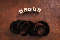 Movie title test letters and film object. High angle view of movie filmstrip and movie text letters message royalty free stock images