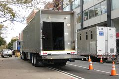 Movie Trailers. Parked in the Lower East Side of Manhattan.  Film and television production in New York City employs 130,000 people and generates over $7 Royalty Free Stock Photography