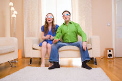 Movie watching. Happy couple at home watching movie in 3D glasses Stock Photography