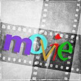 `movie` word written in various colors and with random characters. In the background we have vintage film strip in gray tones. Royalty Free Stock Photography