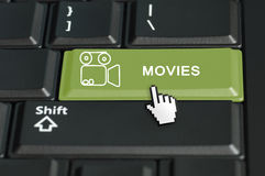 Movies button on a keyboard with mouse cursor. Concept of go to movies call to  action. The focus is on the enter key with the shift button on the bottom Royalty Free Stock Photography