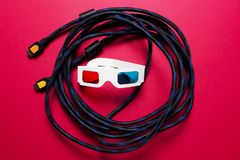Movies concept. HDMI cable and paper 3d glasses. Watch the movie in the 3d house. stock image