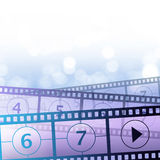 Movies download. Filmlets before a blue backgropund Stock Photos
