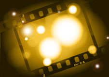 Movies film light background. Film illustration, lighting, fuzzy, the aperture is auxiliary visual elements Royalty Free Stock Images