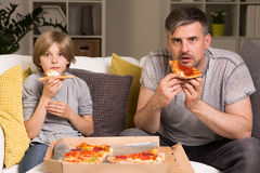 Movies plus pizza equals perfect plan for the evening Stock Image