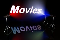 Movies sign. On black background lit by multycolored lights Stock Photos
