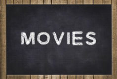Movies  - text on chalkboard Stock Images