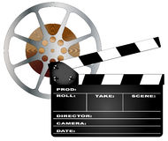 Movies. A typical movie clapperboard and tape reel isolated over a white background Royalty Free Stock Photos
