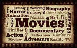 Movies words on old filmstrip background. 26 different types of movies Stock Photography