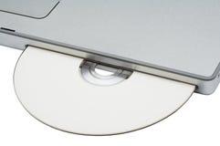 Movimentação de CD-ROM no caderno moderno Imagens de Stock Royalty Free