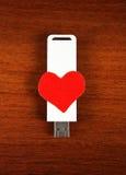 Movimentação do flash de USB com forma do coração Fotografia de Stock Royalty Free