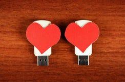 Movimentação do flash de USB com formas do coração Fotografia de Stock Royalty Free