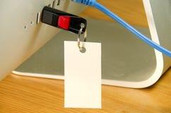 Movimentação do flash do USB com um cartão no computador Fotos de Stock Royalty Free