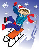 Movimentações do menino em um sledge Imagens de Stock