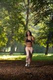 Movimentar-se adolescente no nascer do sol no parque Imagens de Stock Royalty Free